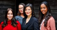 A diverse group of four female leaders in higher ed faces the camera