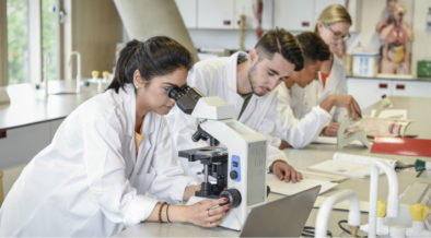 A group of students performs lab work.